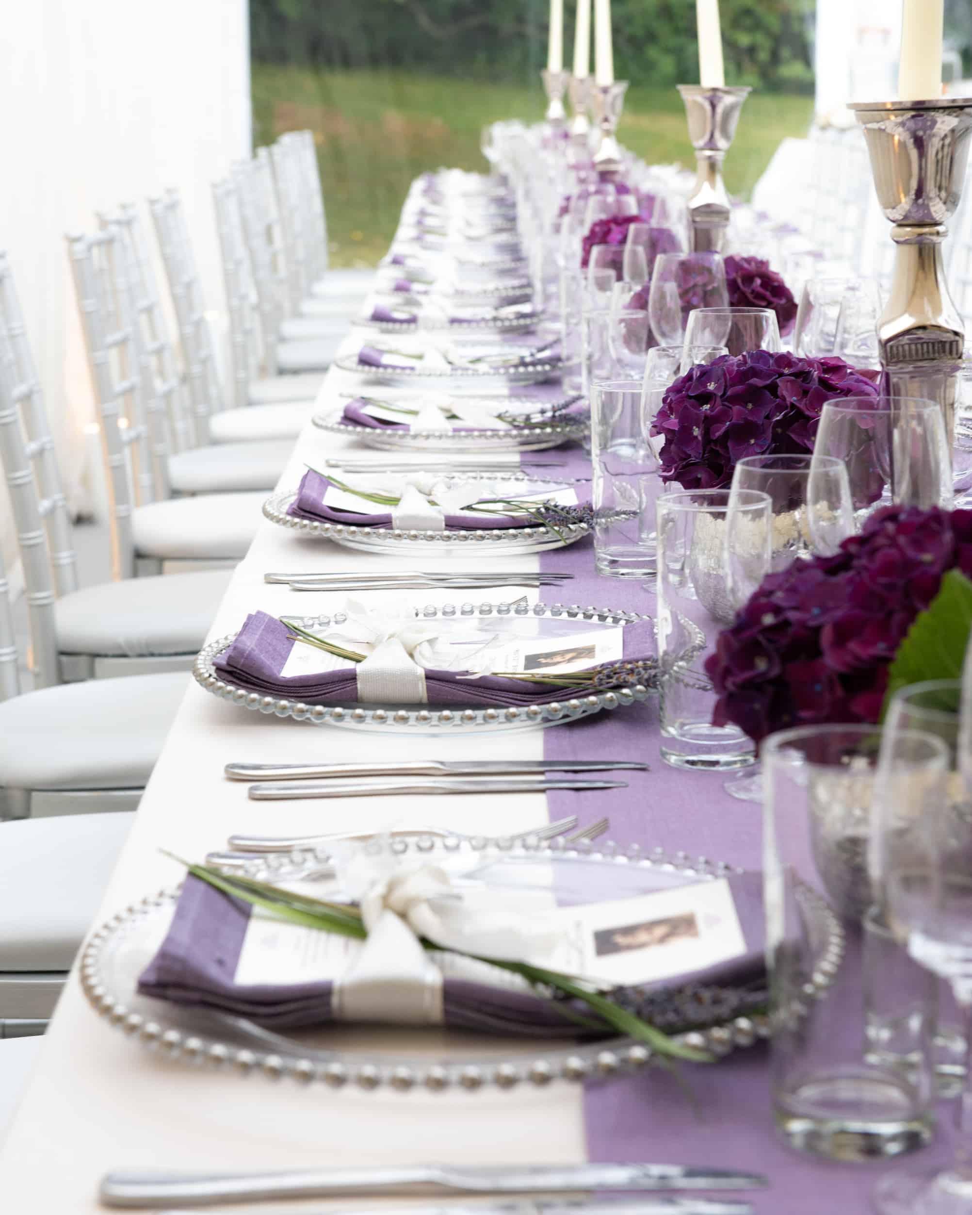 Purple napkins on charter plates