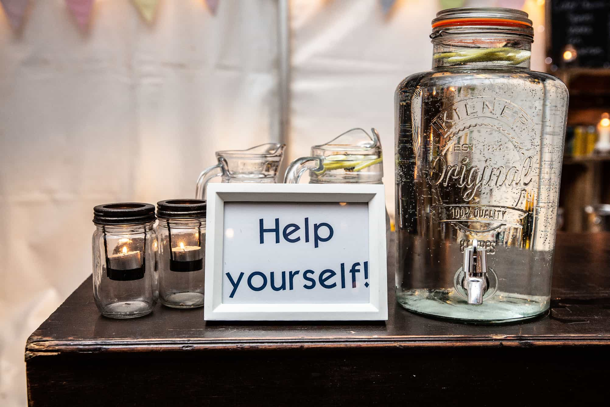 Kilner jar filled with water at an event in a marquee