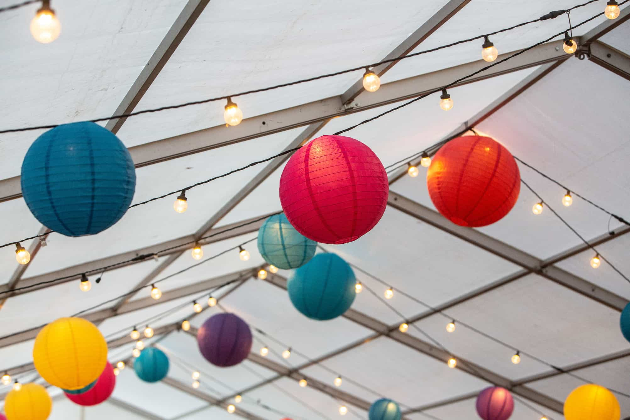 Colourful lanterns within a marquee