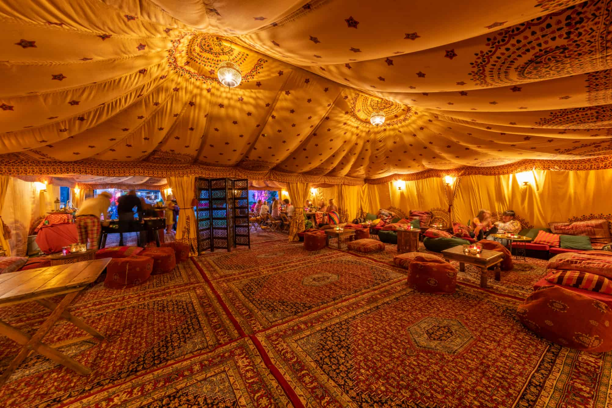 Inside an Arabian tent with persian rugs