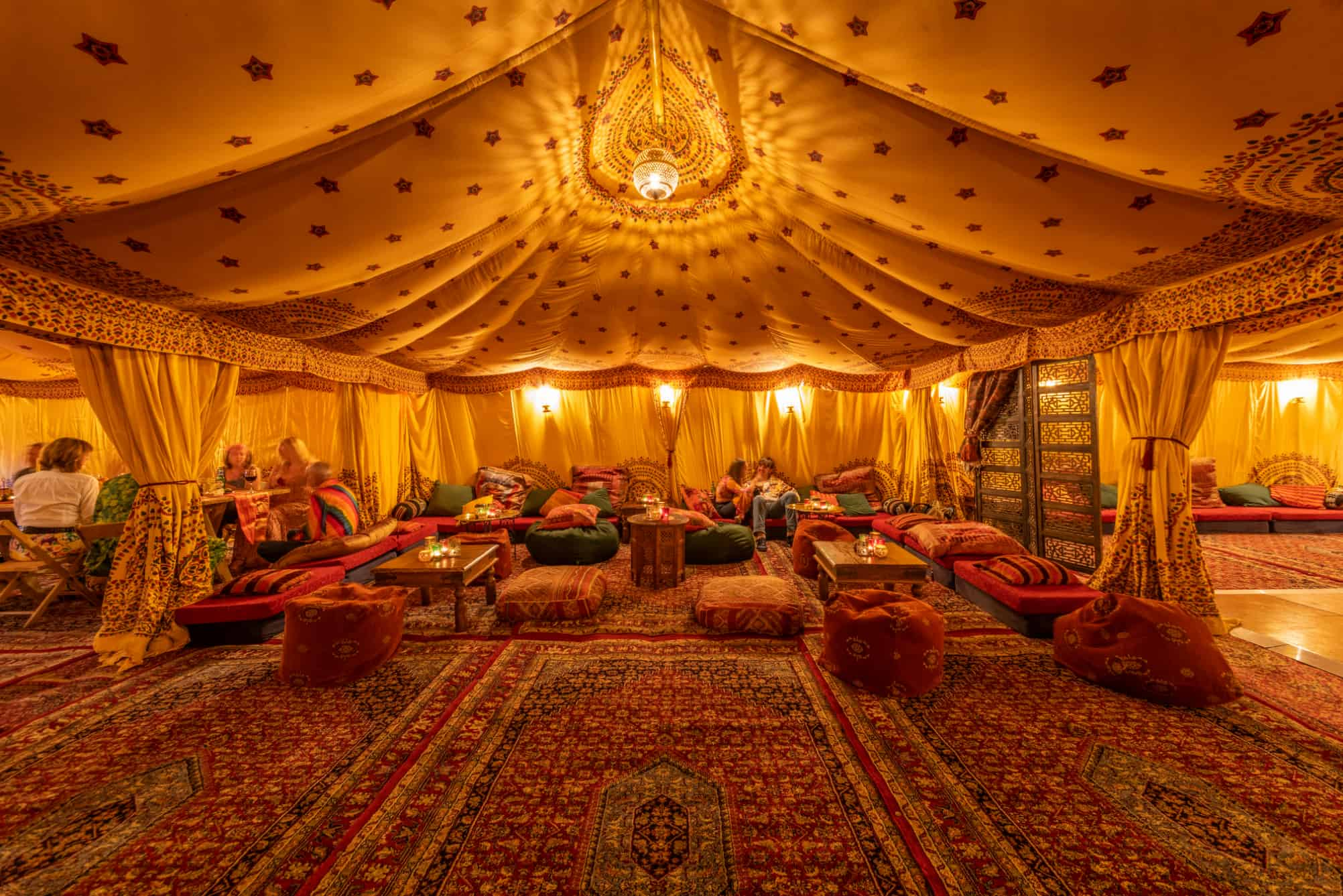 Inside an Arabian tent with low seating