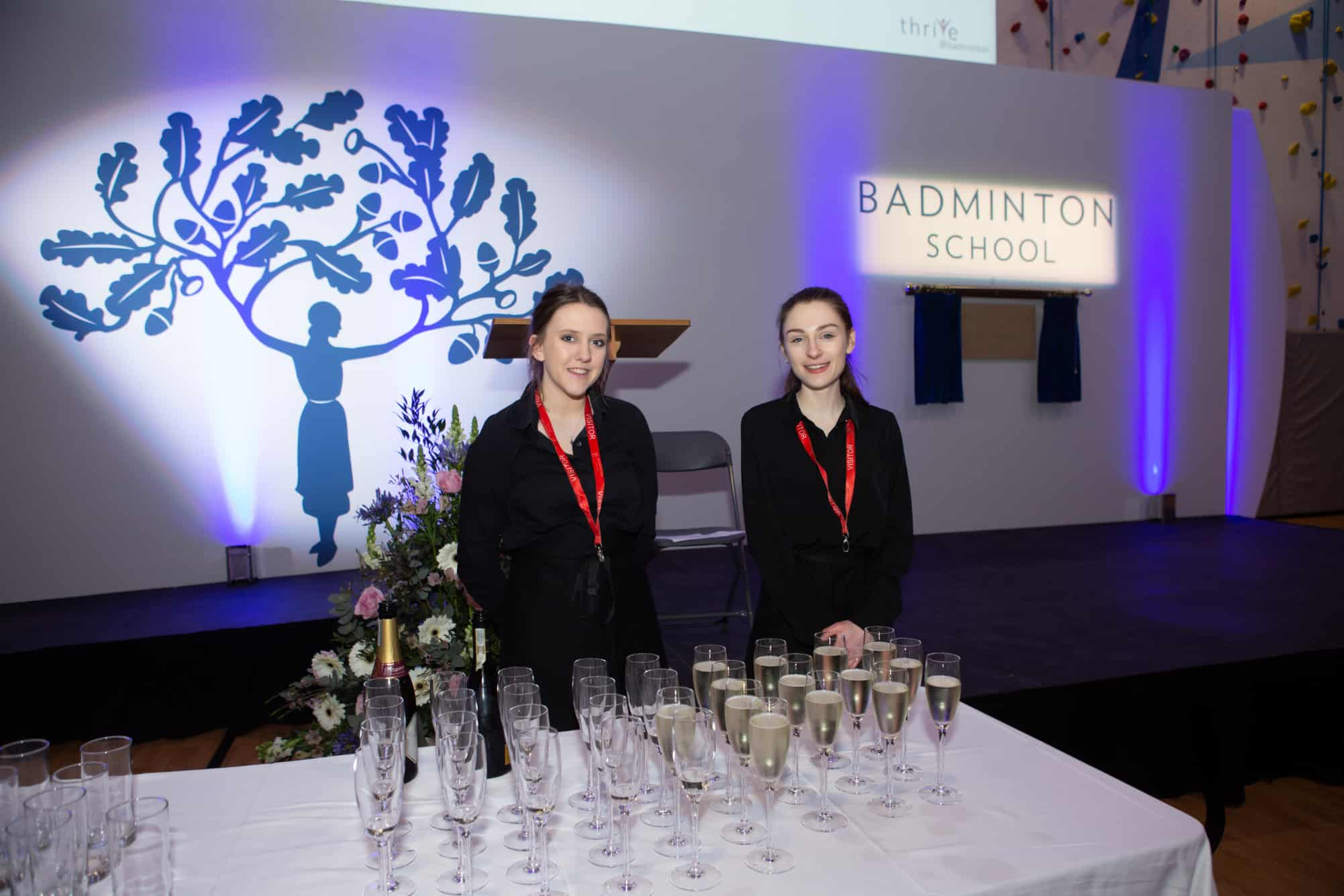 Staff serving drinks at an event within a sportshall