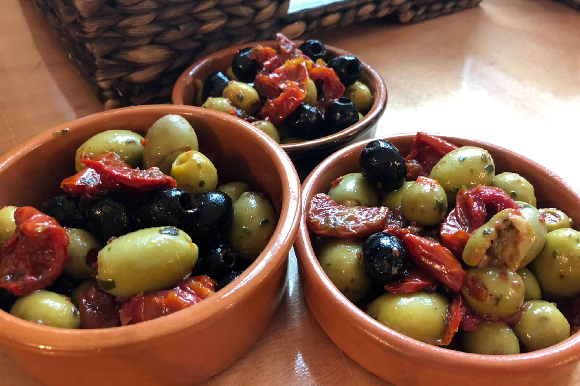Olives served in terracotta pots for a party at home in Bristol