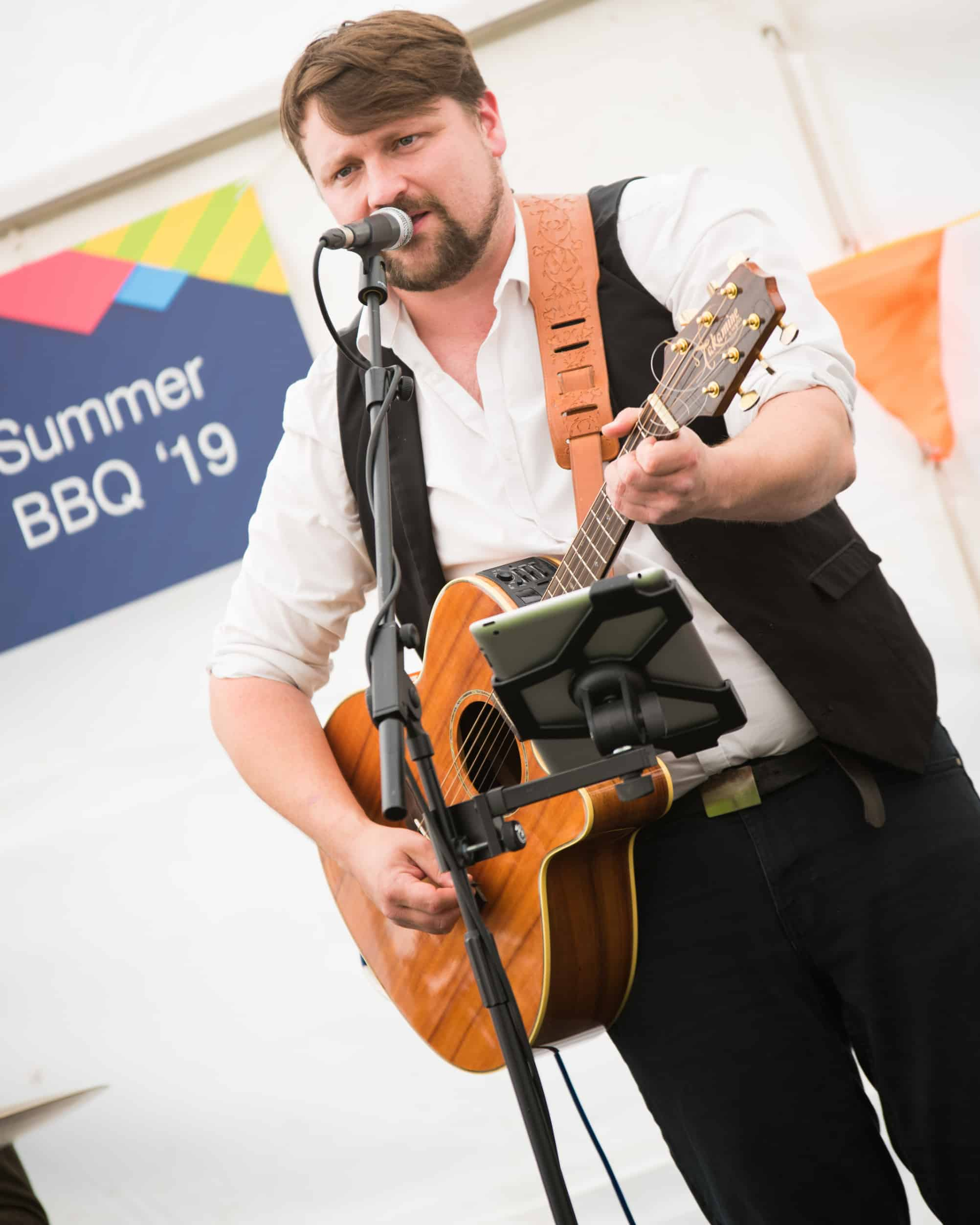 Acoustic performer marquee party