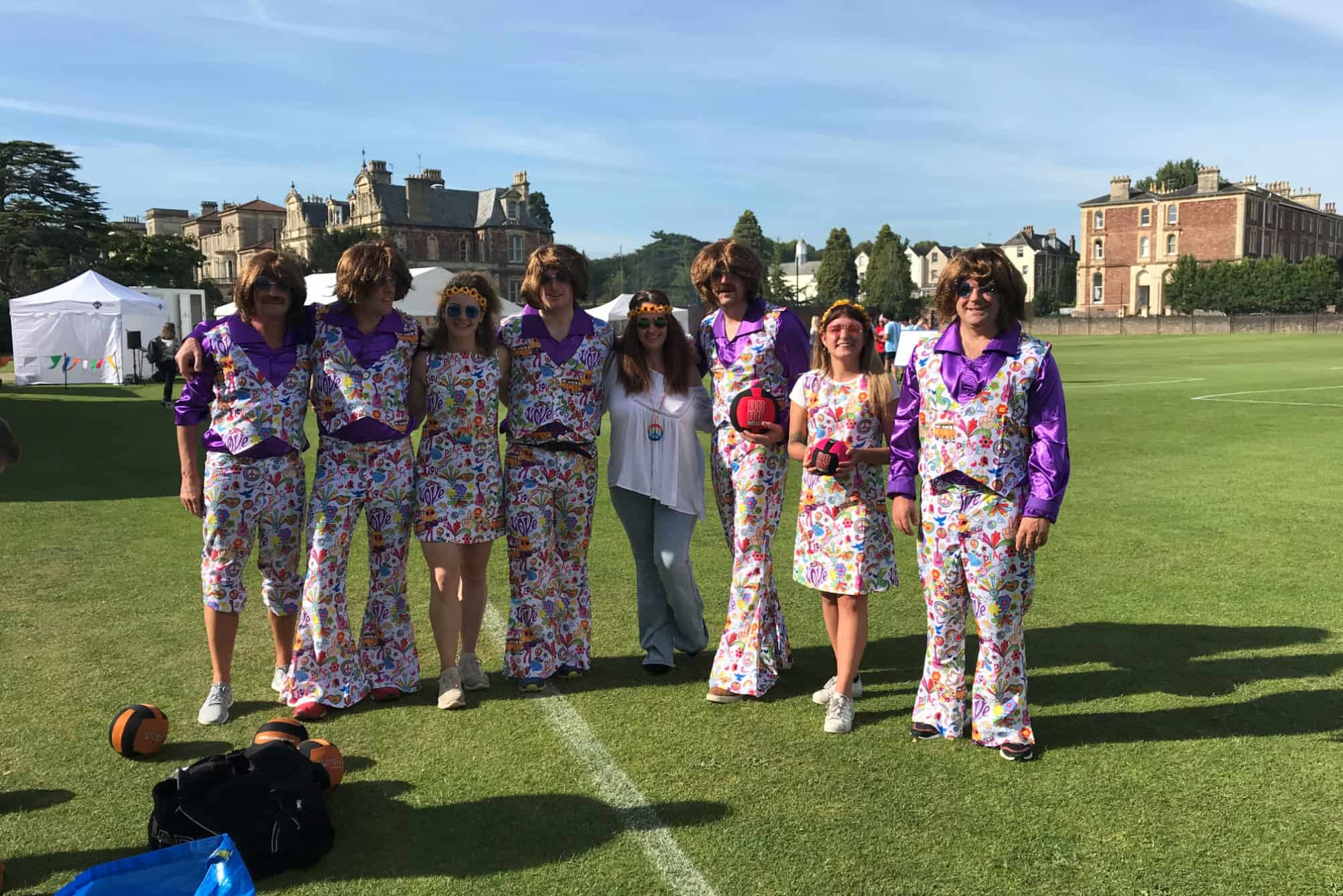 Dodgeball tournament participants dressed in 1970s fancy dress
