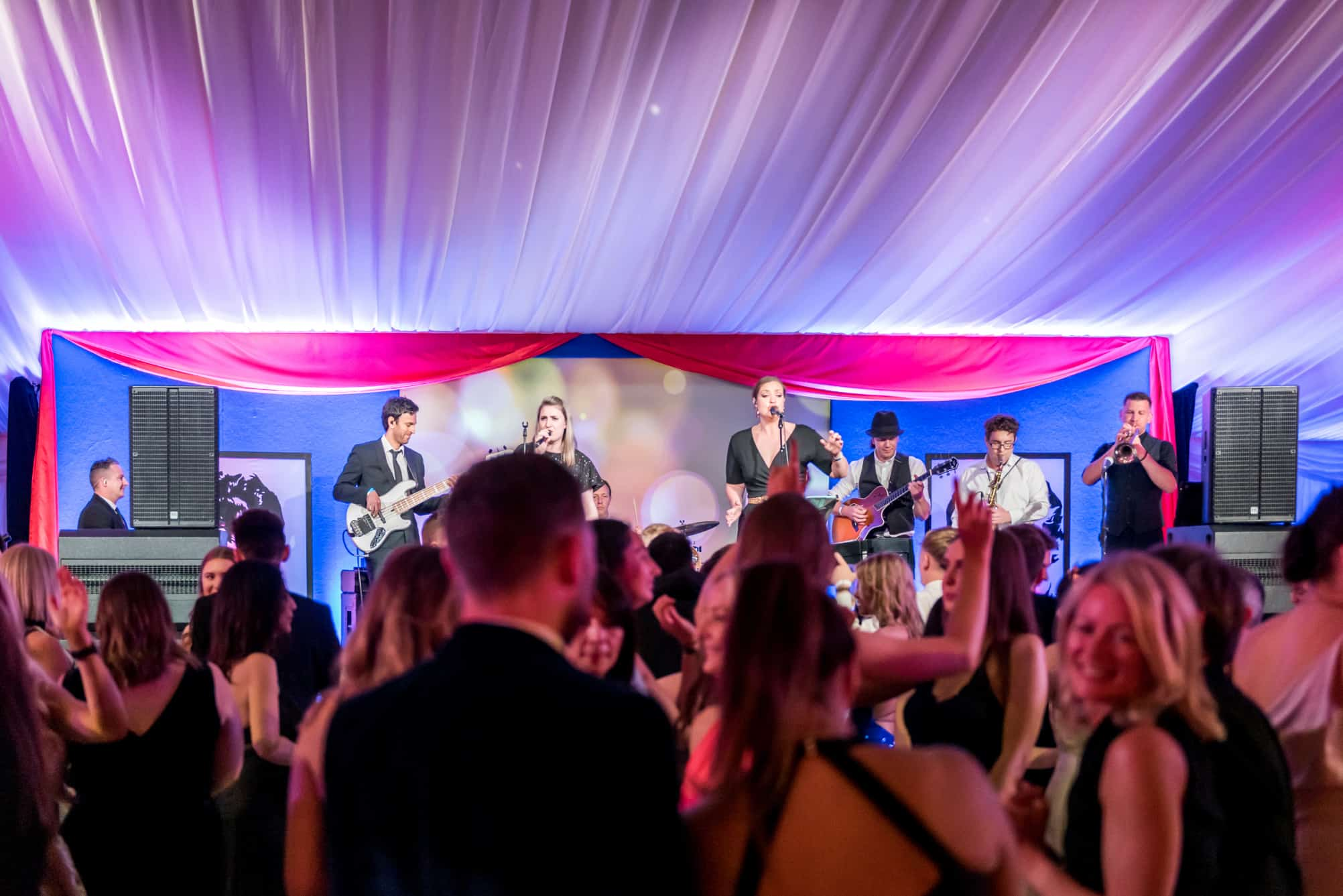 The band playing within a marquee at Clifton College, Bristol