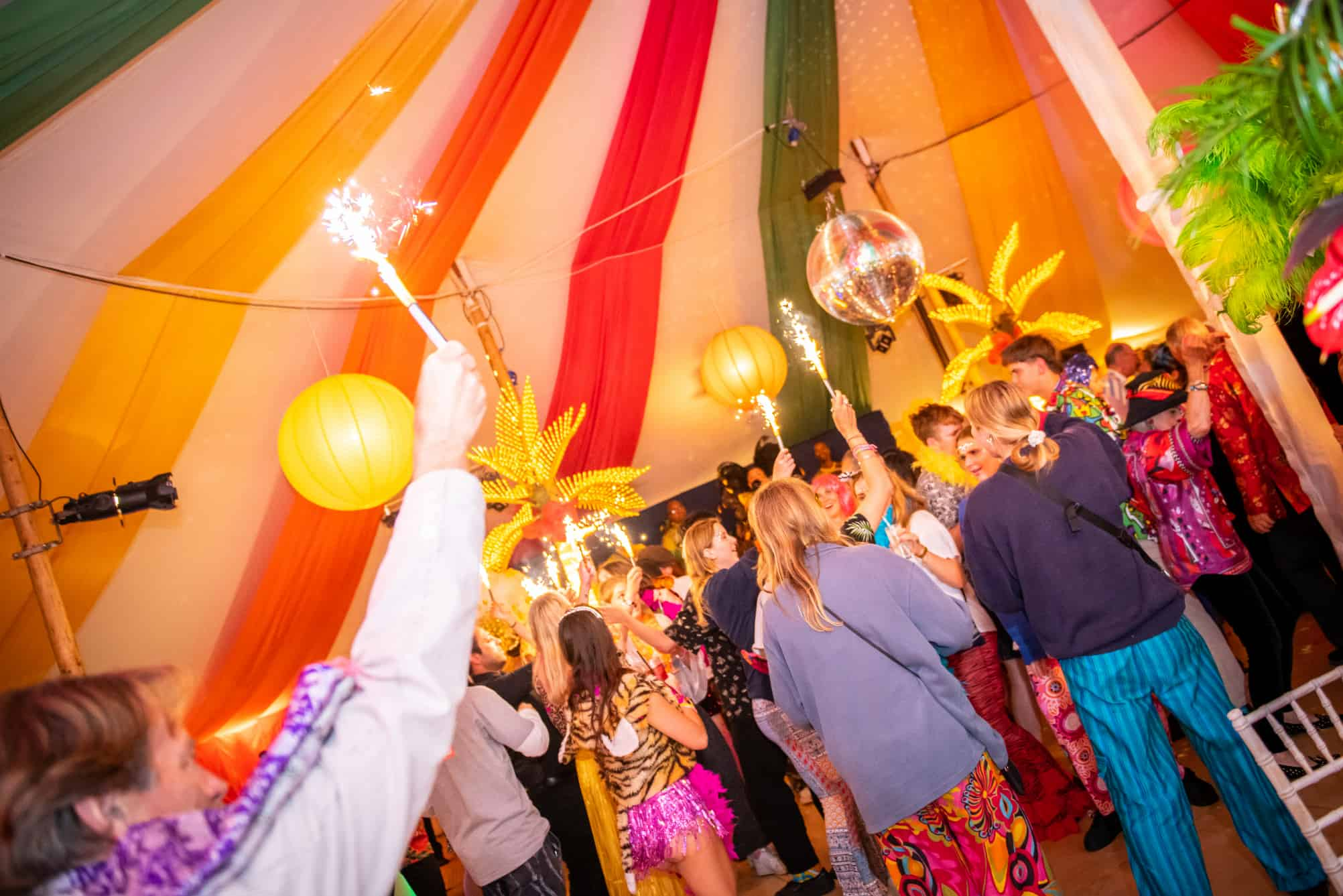 Dancing within a carnival themed marquee